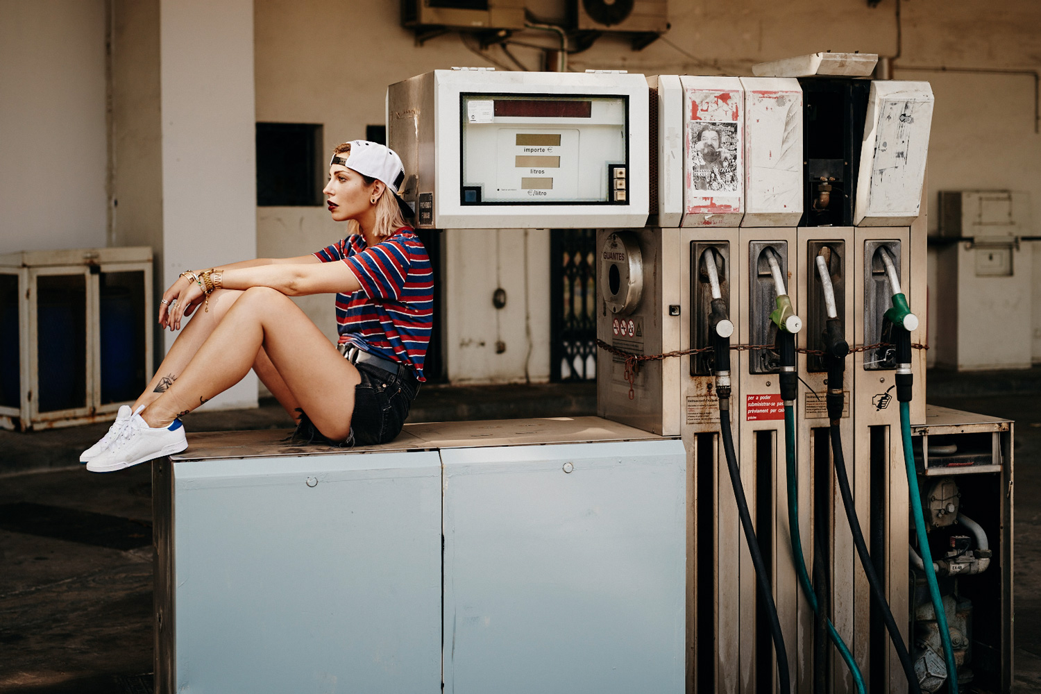 Editorial shooting location: Gas Station | sporty style | striped shirt from Iro Paris and vintage shirts | sneakers from Reebok x Face collection
