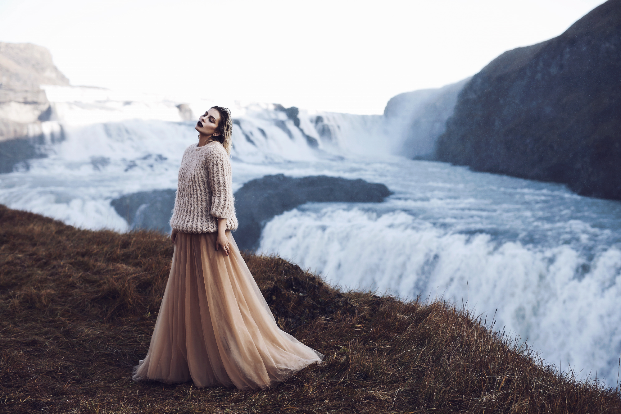Waterfall in Iceland | Editorial Fashion Shooting for mybestbrands | style: feminine, melancholic, winter princess