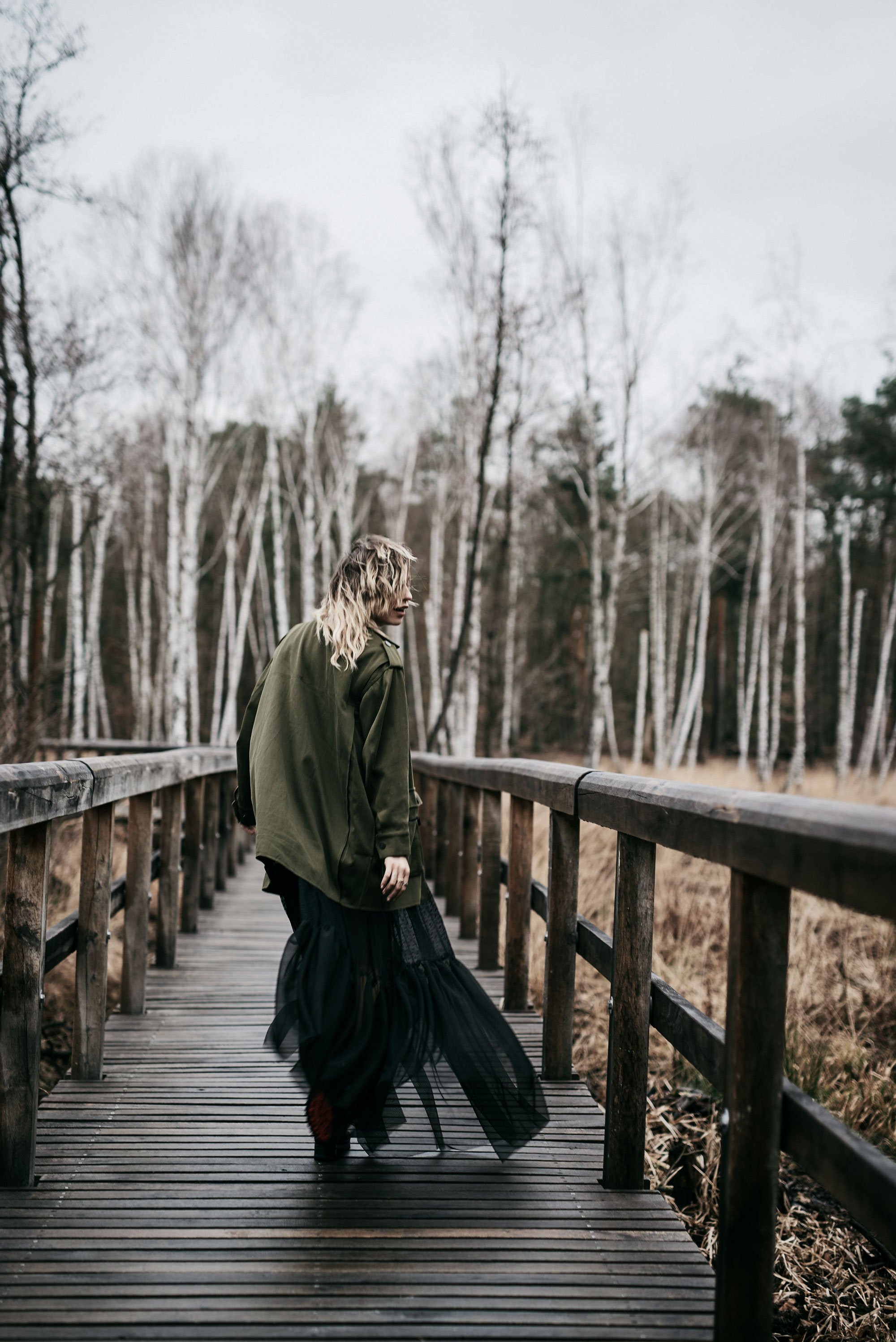 emotional fashion editorial in a birch forest | outfit style: dark, sad, grunge, edgy, goth, sexy | Vogue, black maxi skirt and military coat