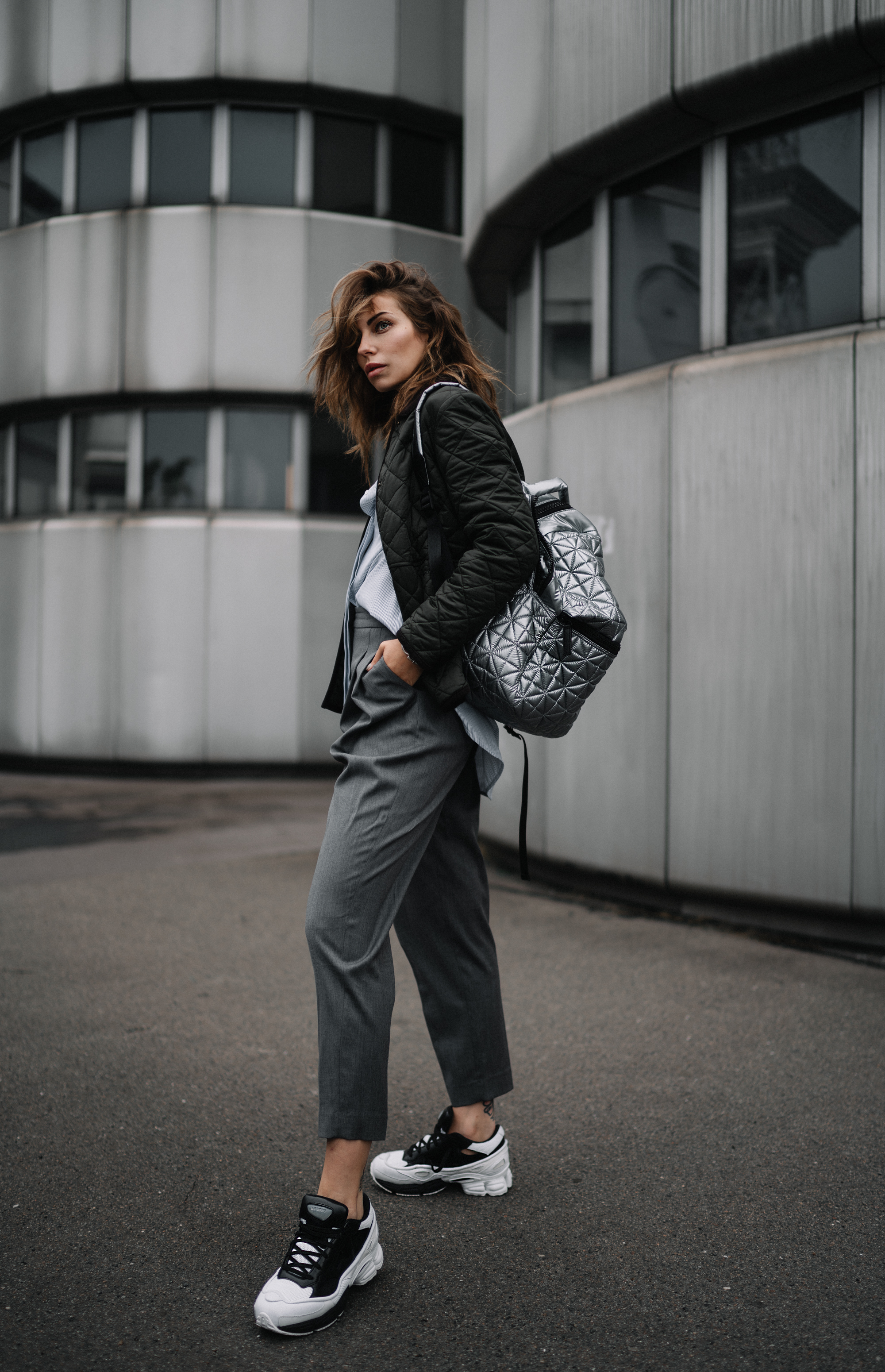 ICC Messedamm Berlin | Fashion & Style | effordless, cool, sporty, Athleisure, Tomboy | wearing: Sneakers from Adidas x Raf Simons, Vee Collective Backpack in silver, Barbour jacket | Architecture Brutalism
