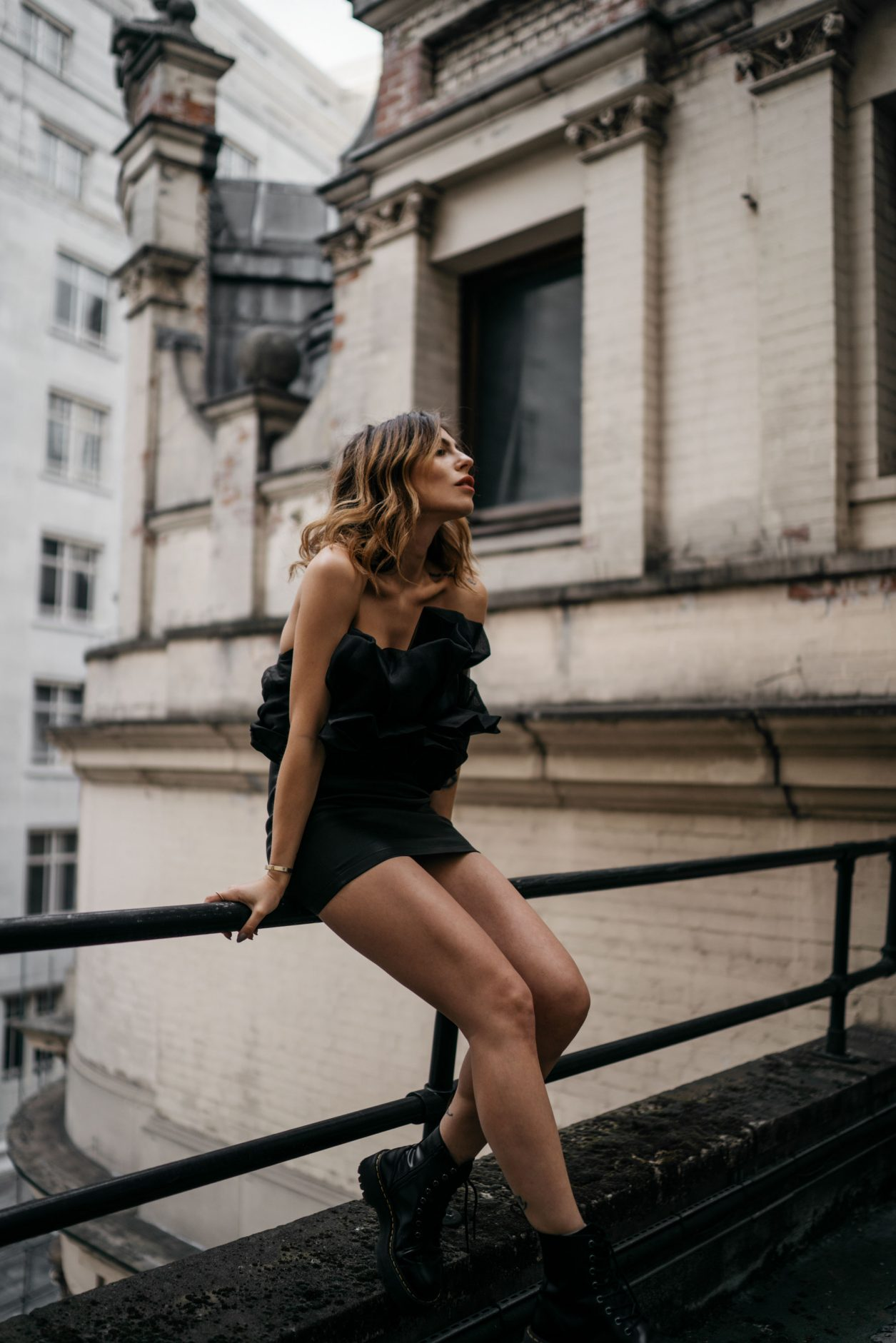 Fashion Editorial Shooting on a London Rooftop | The Savoy | via Masha Sedgwick | little black party dress from Turkish designer Zeynep Arcay | sexy, festive, chic | Parisienne