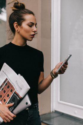 Business lady holding financial magazine from Germany FAZ