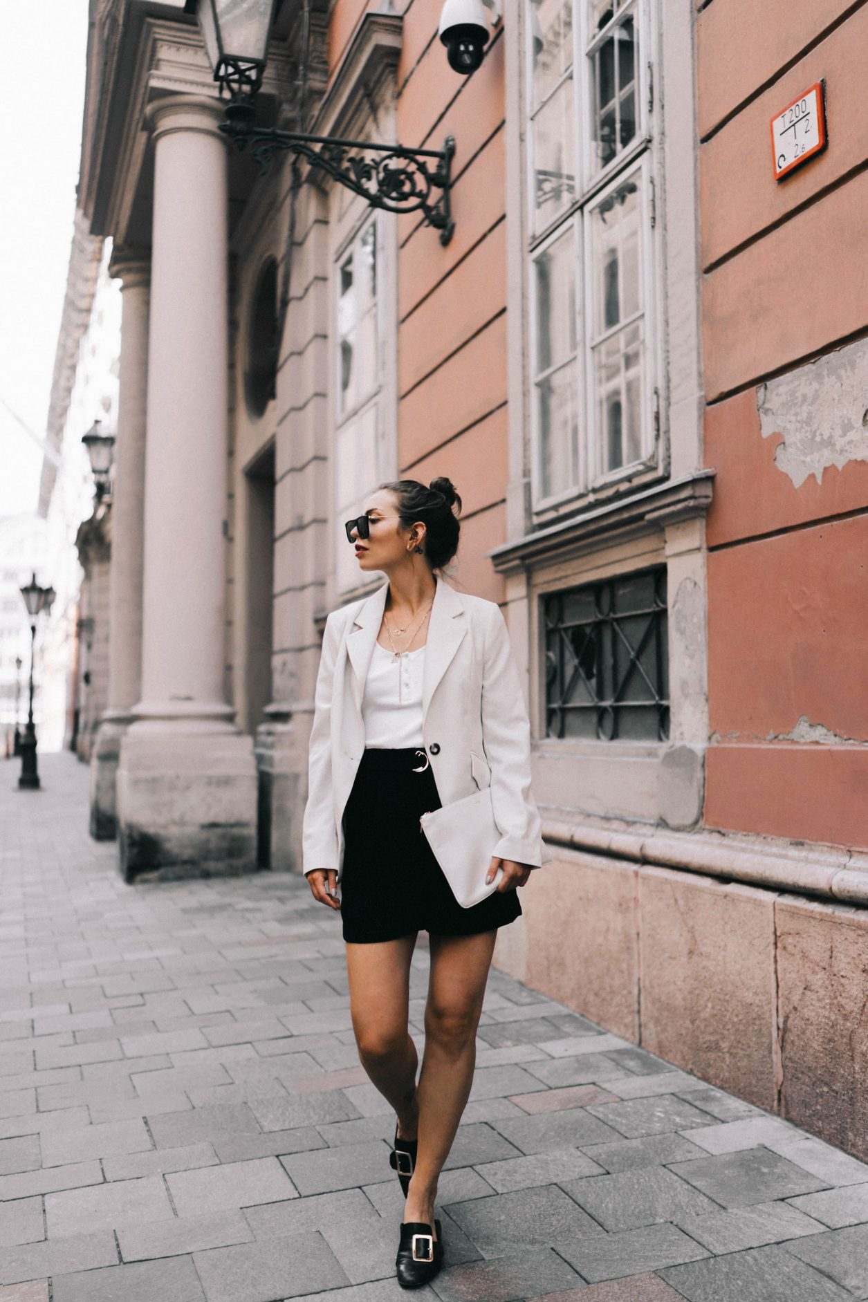 A summer business look for women, Streetstyle from Budapest, Hungary Blazer: Baum und Pferdgarten Top: Gestuz Shorts: H&M Sunnies: Polaroid Loafer: Bally Clutch: Jil Sander