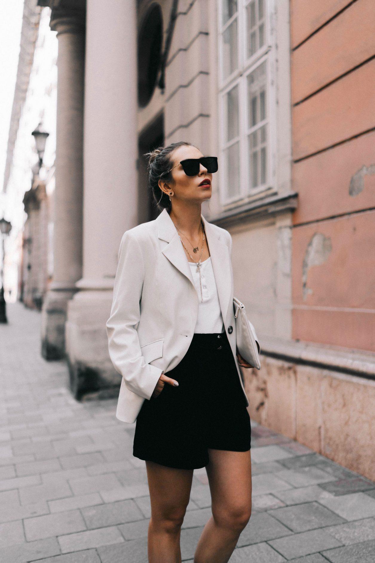 A summer business look for women, Streetstyle from Budapest, Hungary Blazer: Baum und Pferdgarten Top: Gestuz  Shorts: H&M  Sunnies: Polaroid  Loafer: Bally  Clutch: Jil Sander