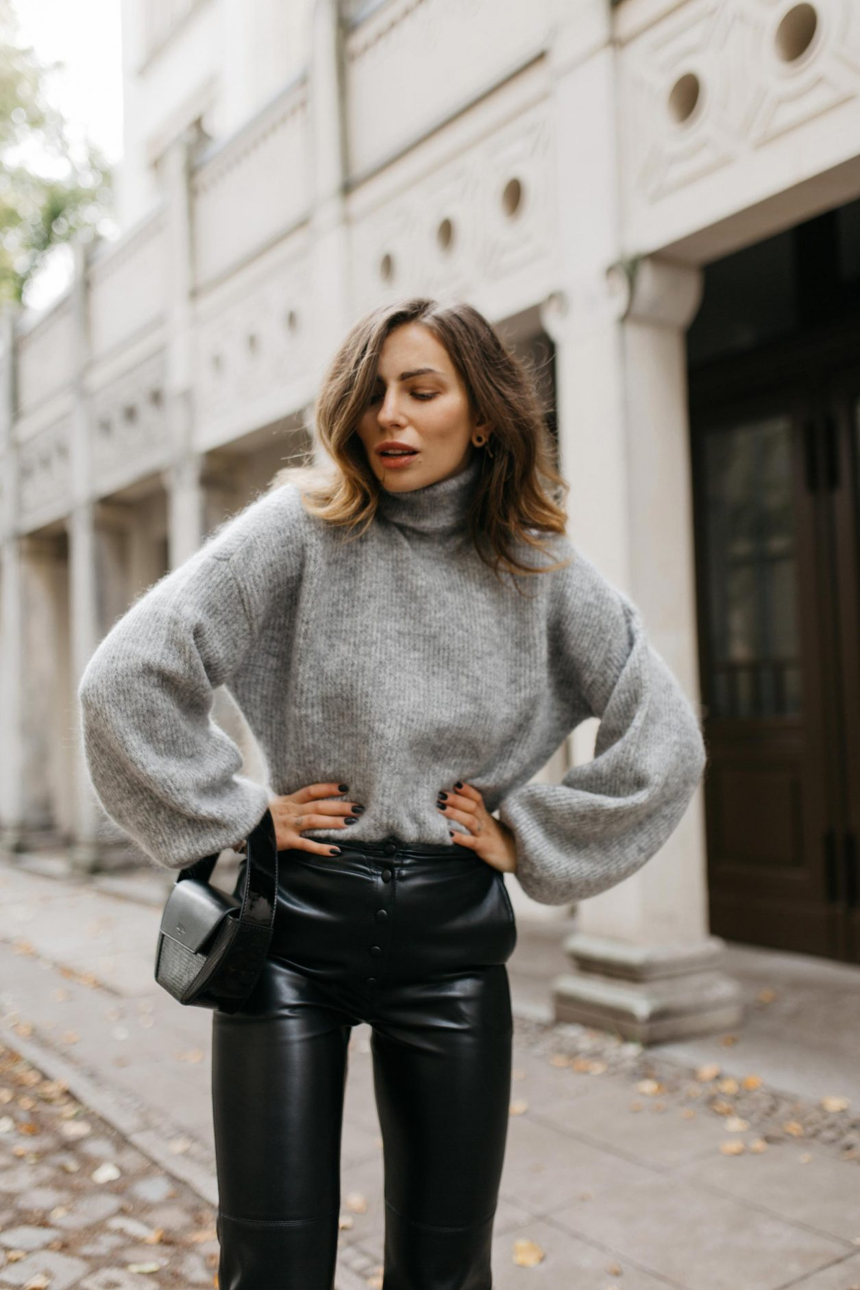 AW19 Streetstyle by Masha Sedgwick, wearing Leather Pants: Nanushka Knit: Gestuz Jacket: Samsoe Samsoe Bag: Lili Radu  Slingbacks: Charles Keith