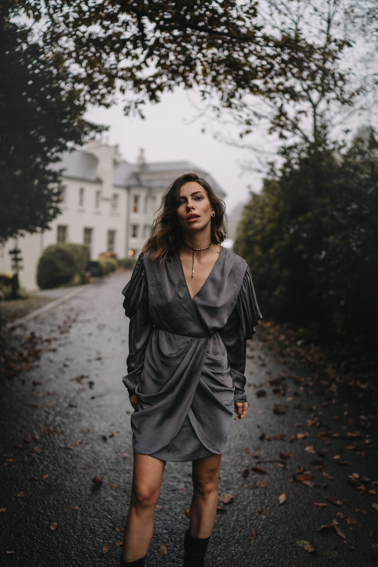 Fashion Editorial via blogger Masha Sedgwick | mood: foggy, moddy, dark woods, spooky, Halloween, festive, vintage | grey party dress via Designers Remix (sustainable) | Location: Beech Hill House Hotel in Northern Ireland (Londonderry) |  in the movement, running, fog