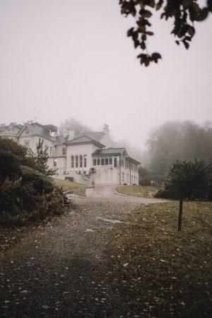 Fashion Editorial via blogger Masha Sedgwick   mood: foggy, moddy, dark woods, spooky, Halloween, festive, vintage   grey party dress via Designers Remix (sustainable)   Location: Beech Hill House Hotel in Northern Ireland (Londonderry)  