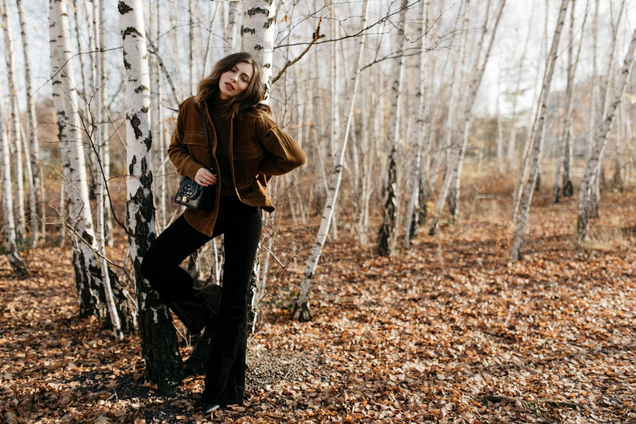 Streetstyle editorial by Masha Sedgwick   Fall winter country style outfit, wearing  tobacco Closed pullover, tobacco cord west by Closed, bootcut jeans by J Brand, brown Escada belt, black black leather cross body bag By Malene Birger   Berlin photo spot: birch park