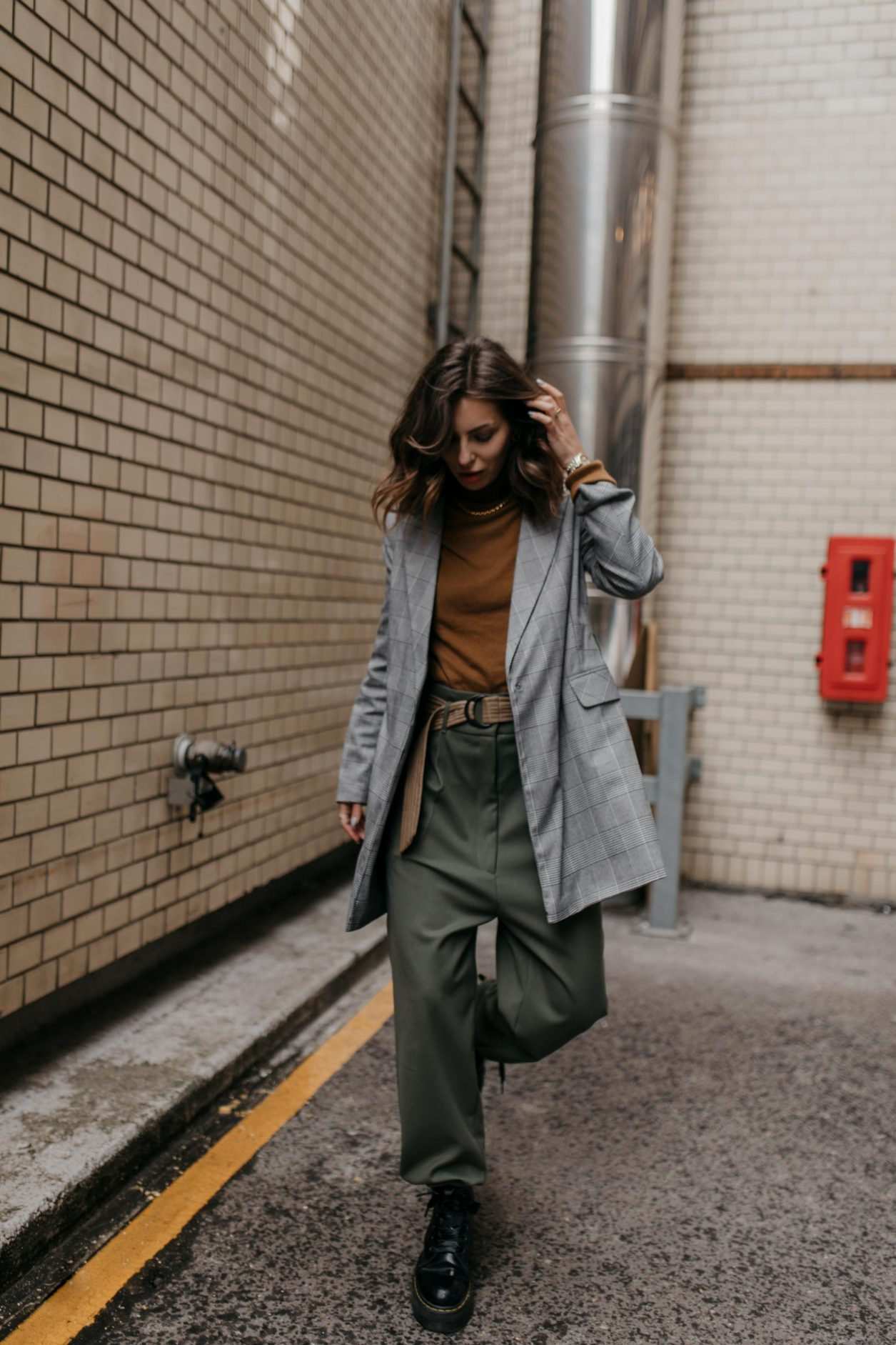 Streetstyle by Masha Sedgwick | Fashion blogger from Berlin, Germany | Everyday outfit inspiration, business casual looks, minimalistic, effortless cool | Outfit: grey checked Topshop blazer, mustard brown Uniqlo roll-neck, khaki green military Munthe pants,  black leather Dr.Martens boots #ootd