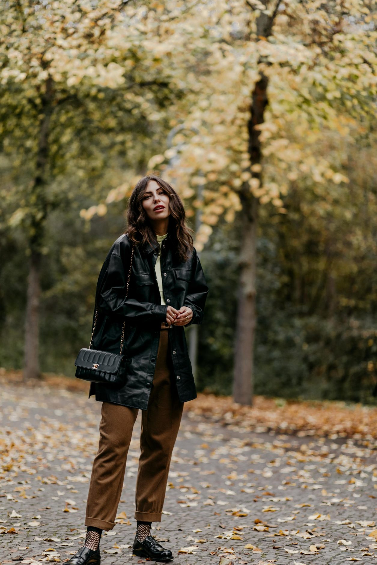 Fashion Blogger Masha Sedgwick | Fall outfit inspiration wearing animal printed zebra Coat: Lala Berlin Rollneck: Set Faux Leather Blouse: Gestuz Pants: Joseph (alt) Loafer: Maison Margiela Streetstyle Photographer Tonya Matyu